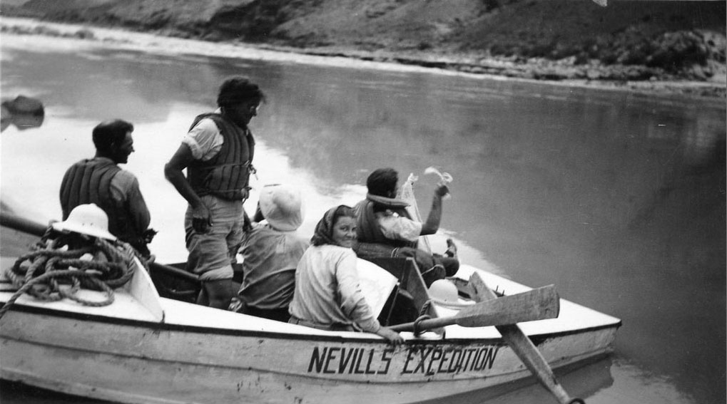 Professor Elzada Clover, standing, and her graduate assistant, Lois Jotter, launch with the Nevills Expedition.