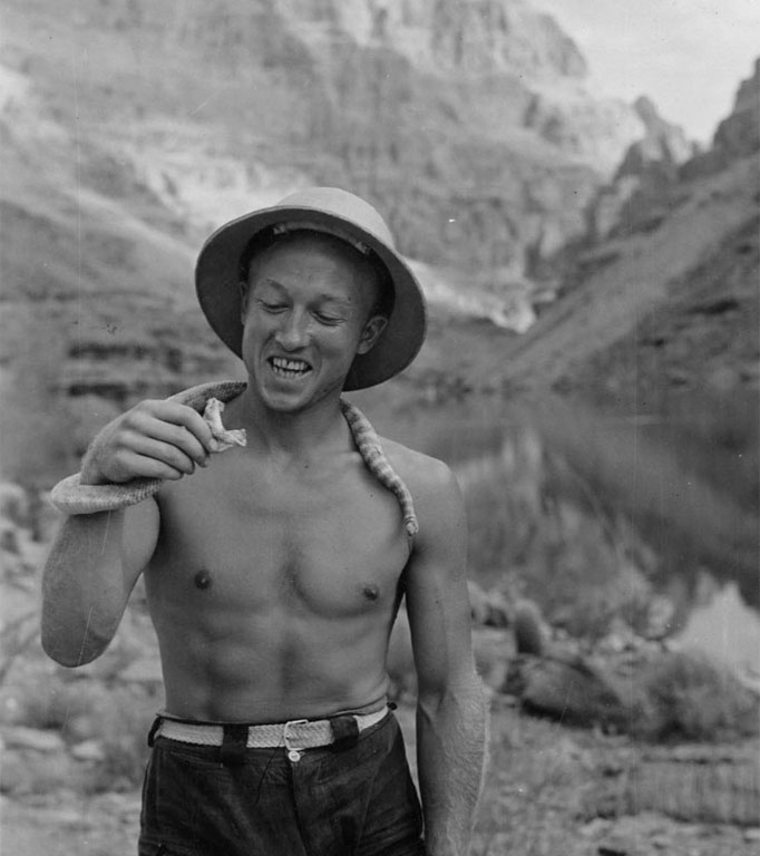 Lorin Bell, who joined the expedition at its layover at Lee's Ferry, with rattlesnake he captured at Quartermaster Canyon.