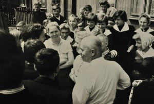 Polish schoolchildren crowd around Revelli and his wife, Mary, during the Symphony Band's 1961 visit to Lodz.