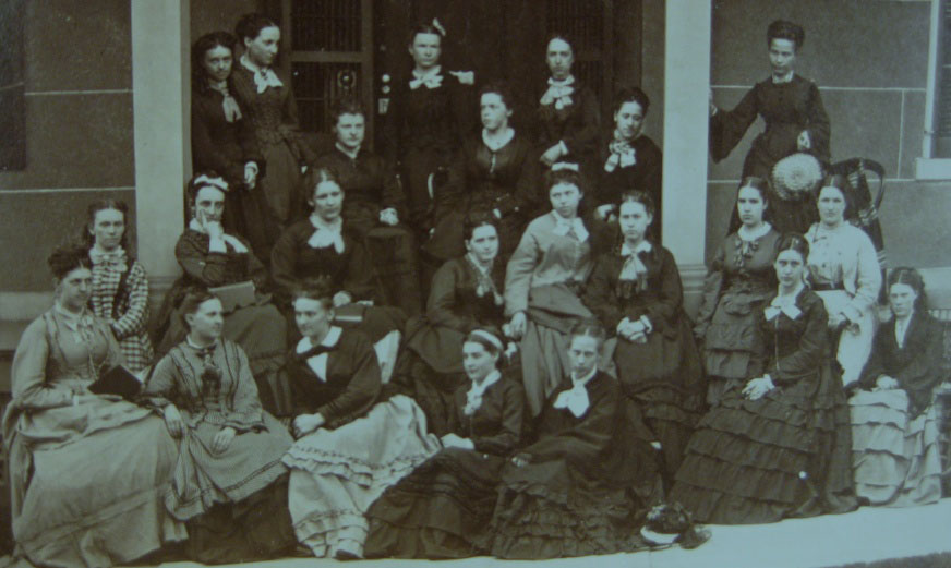 The Quadrantic Circle, Michigan's first organization of women students. The student second from the left in the top row appears to be Mary Sheldon. Her friend Laura Rogers White sits in the bottom row, first on the left. Alice Freeman, who became president of Wellesley College, is in the second row from the bottom, fourth from the right.