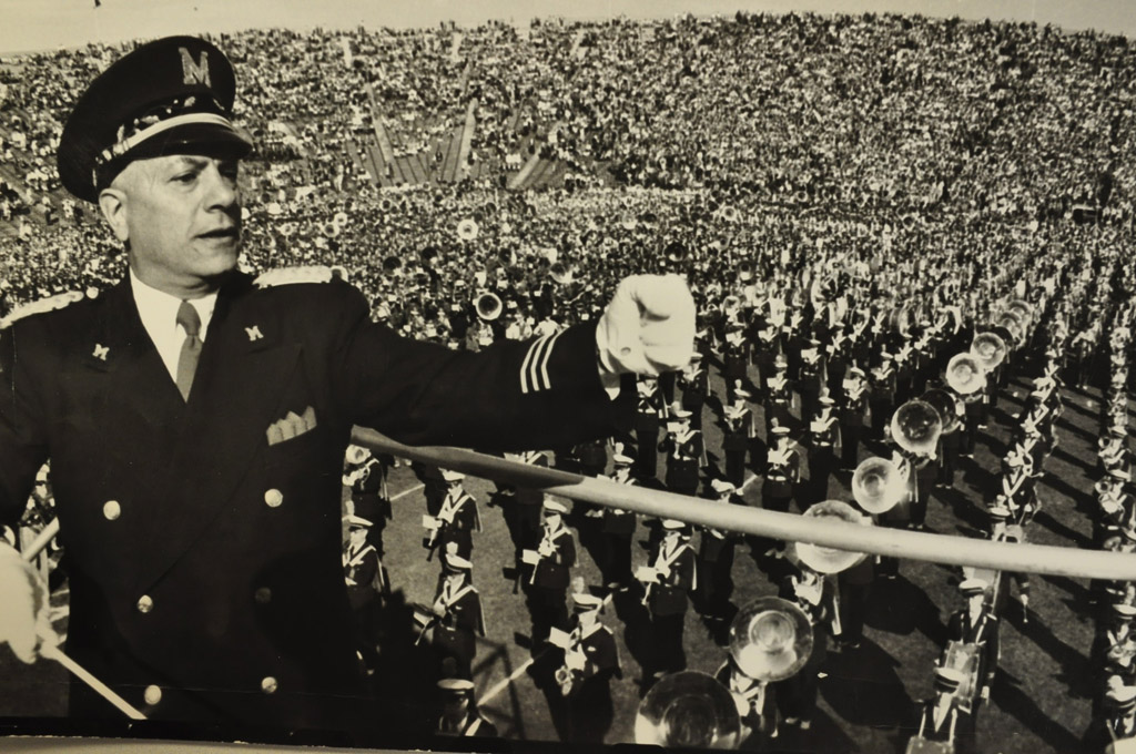 Thousands of high school band students would converge on Michigan Stadium for the annual Band Day instituted by Revelli. Here he conducts the mass band in 1959.