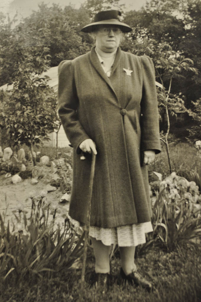 Ruth Buchanan in her garden wearing her Emblem of Honor pin.