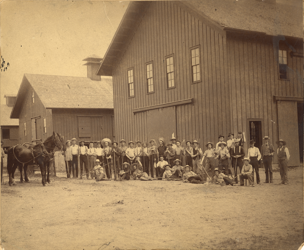 Students gather outside the barns at Michigan Agricultural College in 1886.