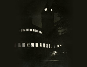 Lights burn in the belfry of one of the old General Library's two towers. After Regents declared the Library a fire hazard in 1915, it was replaced by the building eventually known as North Hatcher.