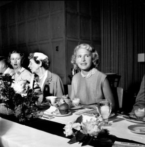 Margaret Bourke-White attends an Alumnae Council luncheon at the Michigan League in 1957. To her right is Florence Ruthven, wife of former President Alexander G. Ruthven.
