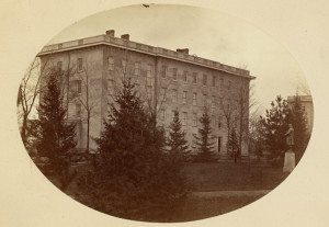 The building called South College, where the custodian Pat Kelly held sway in the University's earliest years in Ann Arbor. Completed in 1849, South College housed chemical and medical laboratories, classrooms, and residential rooms for students.