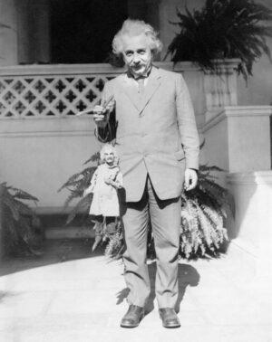 Albert Einstein with a caricature puppet designed by Harry Burnett.